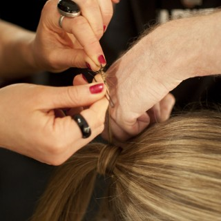 How to pin hair around a ponytail
