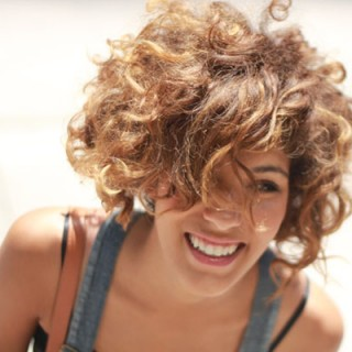 Christina of Trop Rouge has great curls