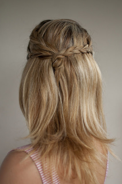 Plaits twisted and tied together create an effortless half up, half ...