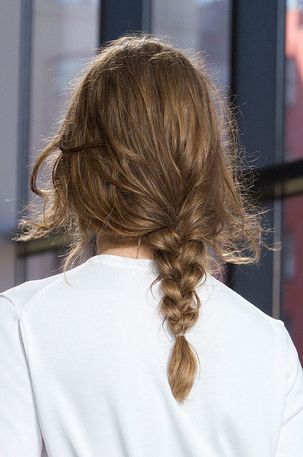 Low messy braids at Michael Kors NYFW SS15